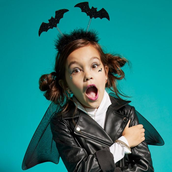 Child dressed in black Halloween accessories from Claires